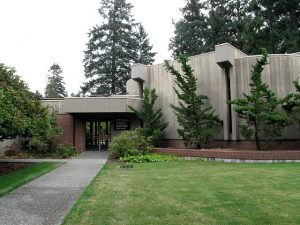 Ingram Hall at Pacific Lutheran University surrounded with green trees.