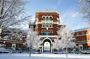 Oregon State University campus during winter with trees filled with snow.