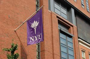 The New York University's torch logo printed on a flag.