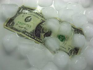 A dollar bill under melting ice cubes.