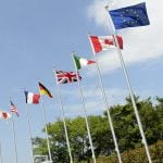 Flags on the pole of the G7 Summit.