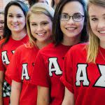Alpha girls from Henderson State University are lining up and smiling.