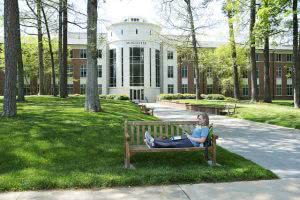 Student studying while sitting on a bench at Berry College.