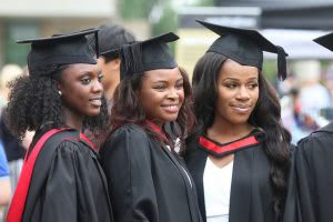 Female graduate students posing for a picture.