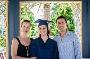College graduate with her parents.