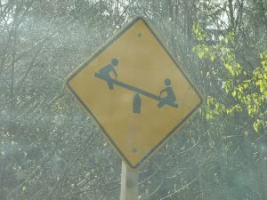 Seesaw road signage.