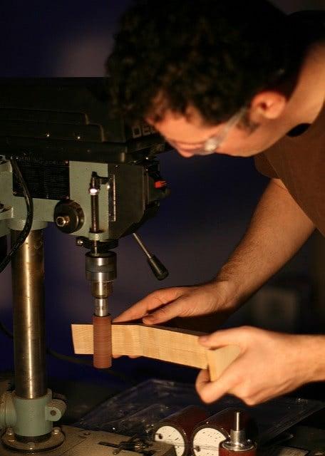 A man working on woodworking machine.