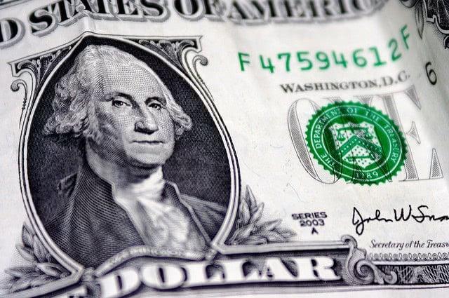 Close up of George Washington in one dollar bill.