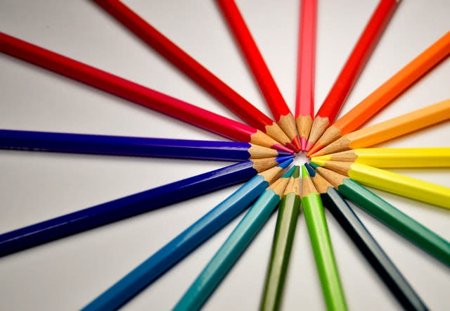 Colored pencils pointing to each other in a circular formation.