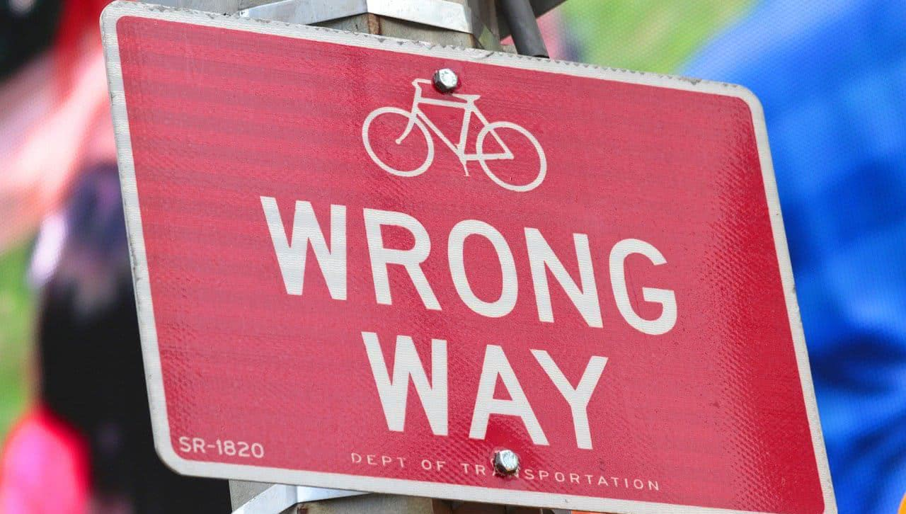 """A red sign that says """"wrong way."""""""