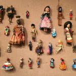 A bunch of hanging dolls in doll exhibit main library.