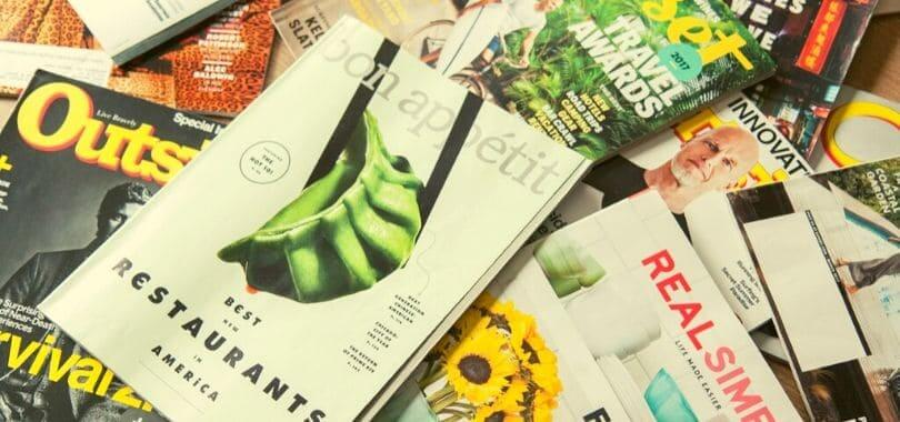 Magazines scattered on top of each other.