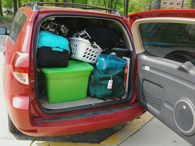 Red van loaded with packed boxes for freshman move-in day.