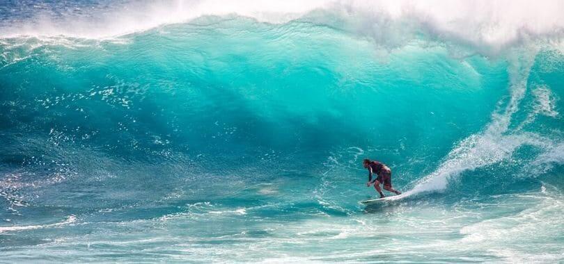 A surfer riding a wave.