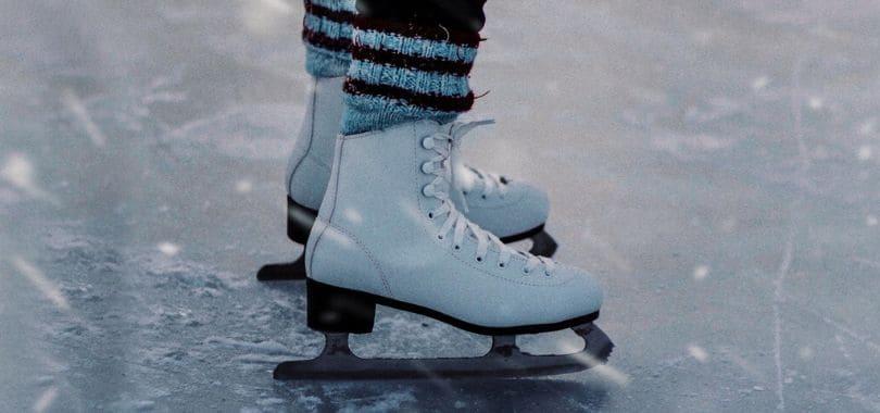A close-up shot of an ice skater's skates.