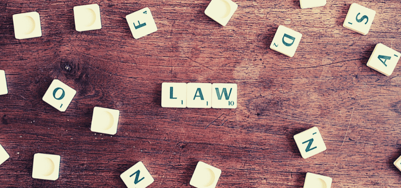 """Letter tiles arranged to say """"law""""."""