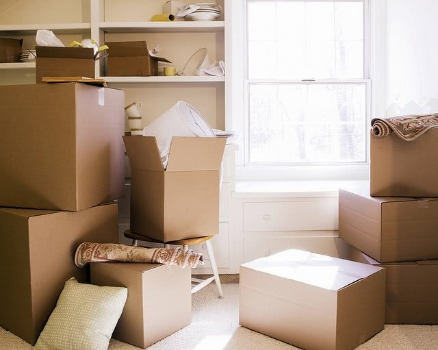 A room filled with different sizes of boxes.