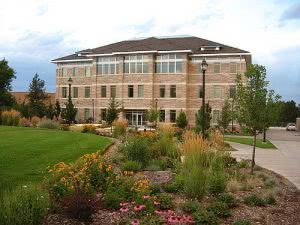 Large lawn in front of a Brigham Young University – Idaho campus building.