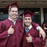Two graduating students thinking about grad school