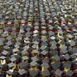 Aerial view of graduates wearing hats.