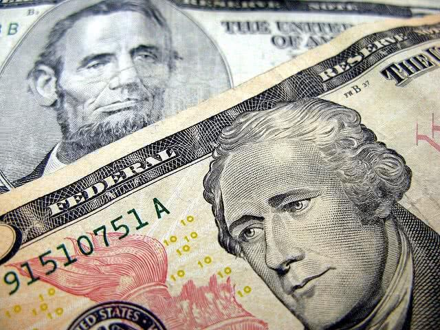 5 and 10 dollar bills - you can save more if you understand the importance of student loan interest rates