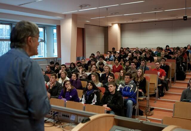 Students in lecture hall explore majors at a college