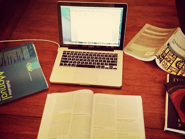 Textbooks and laptop - too much academic rigor can lead to burnout!
