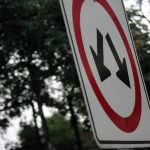 Down arrows on a sign - here's how to lower student loan payments.