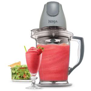 Ninja food blender with strawberry smoothie inside. Click to view its Amazon Page.