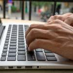 """Student typing on computer, wondering """"what are some things admissions officers don't like"""""""