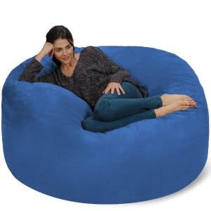A student lounging in a blue Chill Sack bean bag chair. Click to view its Amazon page.