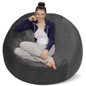 A student sitting in her grey Sofa Sack bean bag chair. Click to view its Amazon page.