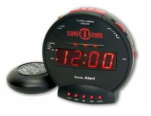 Black and red digital alarm clock showing 12:00 o'clock. Click to view its Amazon page.