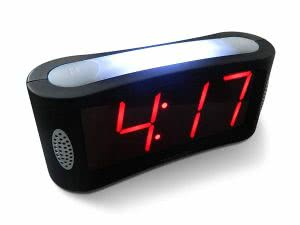 Black rectangular LED alarm clock showing 4:17 o'clock. Click to view its Amazon page.