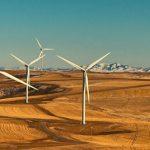 A wind farm spanning across multiple hills.