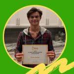 Scholarship Winner Grant Parker posing with certificate
