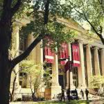 College students walking in front of a Harvard Law School building.