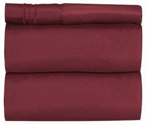 Burgundy folded bed sheets by CGK Unlimited. Linked to its Amazon page.