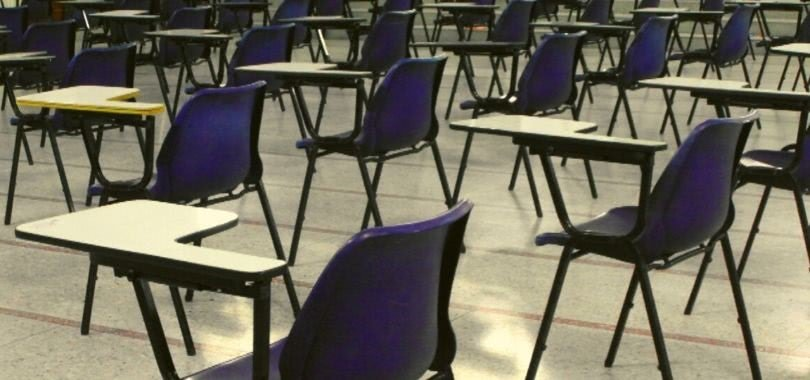 Chairs and desks at an SAT testing center.