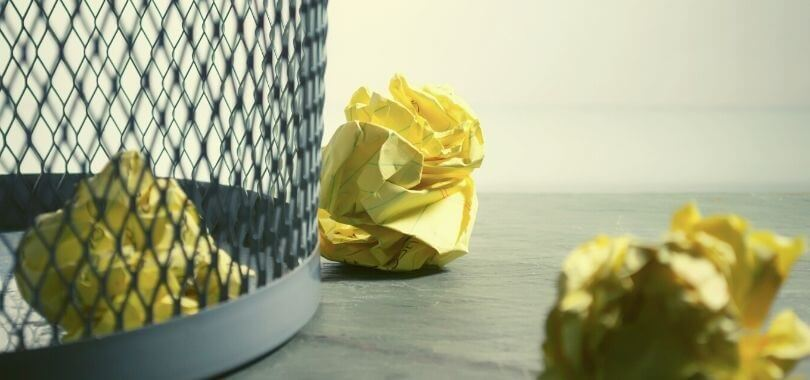 Balled up tests thrown into a wastebasket.