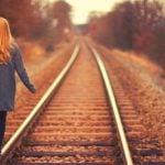 College student on train tracks
