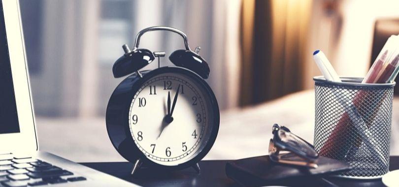 College student's alarm clock sitting on a desk.