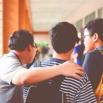 Three high school friends discuss college acceptance odds.